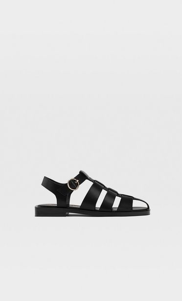 Black flat woven sandals offers at S$ 69.9