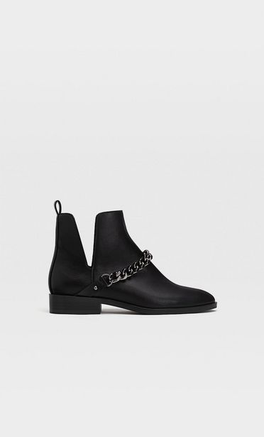 Black vented flat ankle boots offers at S$ 69.9